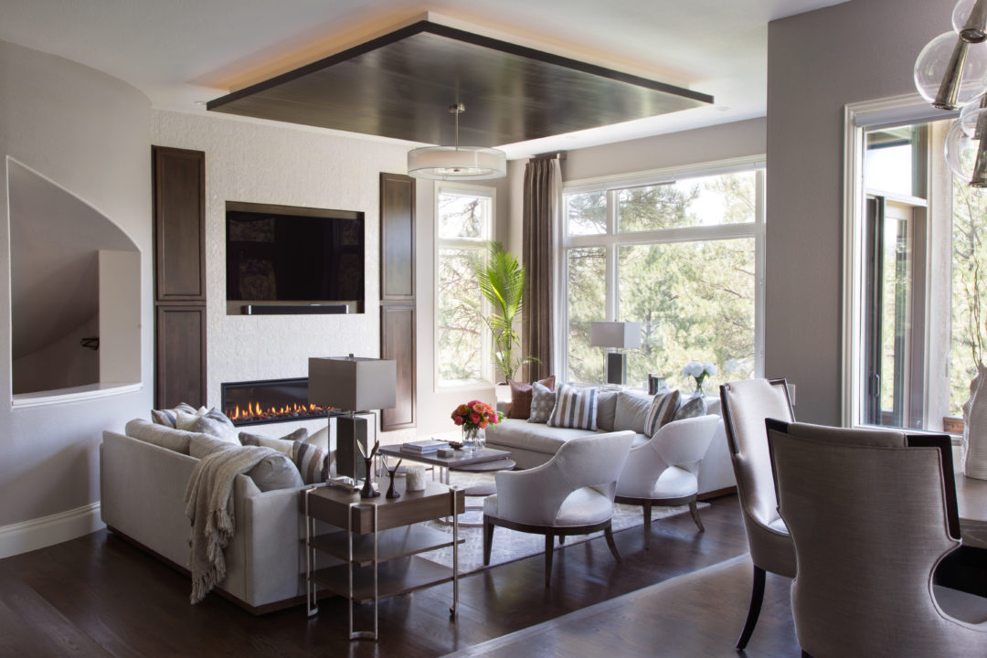 living room with neutrals and dark wood floors, dropped lighted ceiling
